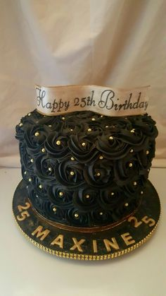 Beautiful black and gold rosette cake