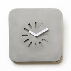 Life in Progress Concrete Clock by Lyon Beton. A version of the icon that has put people on hold around the world is carved in concrete at the center and it features various depths to create the illusion of movement.