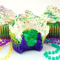 Mardi Gras Cupcakes. Sweet. I always add a couple tablespoons of yogurt in place of whatever liquid when I color batter, because it seems to make the colors brighter.