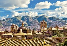 Vacilando: Cuzco, Peru (I love the parallelism of the soft curves from the man-made structure and the natural wonder in the background). I love the variety of lines and curves.