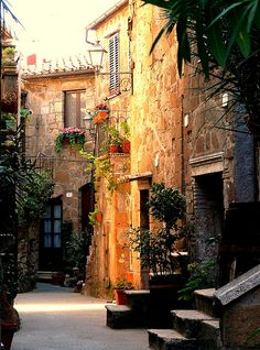 I have a painting in my dining room that looks like this - would love to see in person some day! quiet street in Pitigliano, Toscana