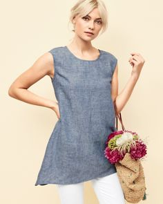 Thoughtful tweaks here and there update a classic linen tunic. Lightweight and lovely, with slight stretch for comfort, darts for shape, and an asymmetrical hem for fun.