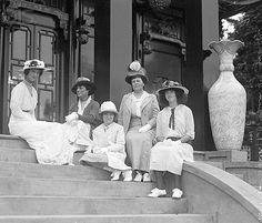 American socialites, Mrs. O.H.P. Belmont, (formerly Alva Vanderbilt) (second on right),  and Consuelo Vanderbilt - Duchess of Marlborough, Alva's daughter, (far left). Seated on the steps of the Chinese Tea House, located behind Alva's, Marble House, in Newport RI. ~ Marble House was constructed between. c.1888 - c.1892. The Chinese Tea House was constructed in c.1914. ~ {cwlyons} ~  (Image via: mrmhadams - blog)