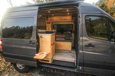 This van conversion was built for taking extended weekend trips, with a double drop down bed, large kitchen galley, and a modular bench seat with a dog bed. Van Conversion Build, Van Conversion Interior, Sprinter Van Conversion, Camper Van Conversion Diy, Ambulance, Motorhome, Build A Camper Van, Campervan Interior, Old School Cars