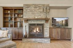 As part of a thoughtful, large- scale remodel, a double door entry leads to an o. - Decoration Fireplace Garden art ideas Home accessories Fireplace Built Ins, Home Fireplace, Fireplace Remodel, Living Room With Fireplace, Fireplace Surrounds, Fireplace Design, Stone Veneer Fireplace, Fireplace Cover, Living Room Remodel