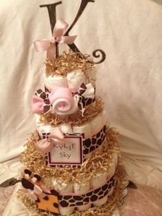 Baby Girl Giraffe Diaper Cake by TheKraftyKornerbyKim on Etsy, $75.00 by Grace Palos