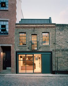 Tasou Associates turns abandoned London warehouse into office A small, neglected warehouse built in the has been renovated by Tasou Associates to create the light-filled 9 Jeffrey's Place office in London. Warehouse Office, Warehouse Design, Warehouse Conversion, Brick And Wood, Building Facade, Shop Facade, Building Renovation, Facade Design, Facade Architecture