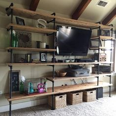 Black pipe and wood entertainment center industrial shelving for the home improvement exciting excellent Industrial Pipe Shelves, Industrial Style, Industrial Lamps, Industrial Living, Industrial Man Cave Ideas, Plumbers Pipe Shelving, Industrial Design, Black Pipe Shelving, Industrial Basement
