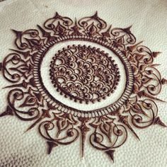 Henna coloured navel centred body art. beautiful and intricate