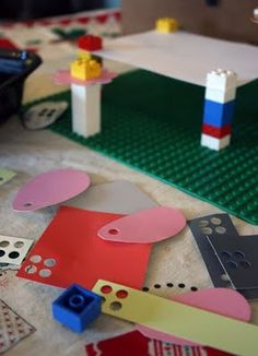 punch holes in papers of different shapes and sizes to use as props with Legos (could work for duplos)