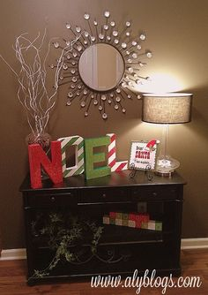 Love the NOEL letters.Front entry way: hurricane filled with pine cones and spray painted branches & NOEL letters. Christmas Time Is Here, Merry Little Christmas, Christmas Love, Winter Christmas, Christmas And New Year, Christmas Letters, Decoration Table, Xmas Decorations, Painted Branches