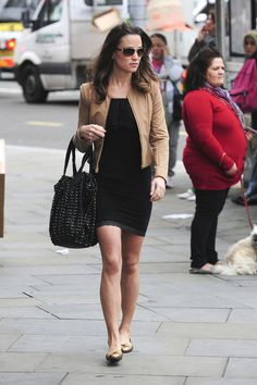 I am totally Team Pippa. Simple styling. Classic. She's the better dresser hands down.
