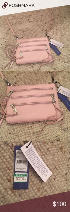 "Rebecca Minkoff 3 Zip Rocker trio of zippers with swingy pulls lends modern edge to a sleek clutch, crafted from lightly textured leather and topped with an optional shoulder strap. Top zip closure. Exterior zip pockets. Interior wall pocket. Leather. 7Lx 9W x 6 ½""H x 1 ½""D. 23"" crossbody strap drop. Rebecca Minkoff Bags Crossbody Bags"