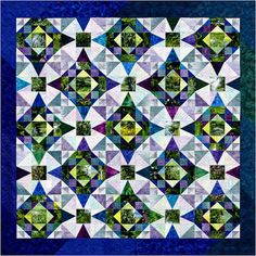 """""""Memories of Monet"""" is a deceptively simple design by color expert Joen Wolfrom. Joen combined two historic blocks, Summer Winds and Storm at Sea, in an analogous color scheme."""