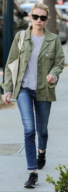 Who made Emma Roberts' green jacket, white stripe tee, black sunglasses, blue skinny jeans, and black sneakers?