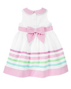 LOVE this bow on the back of the striped dress.
