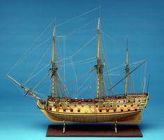 SLR0230 Description	Scale: 1:48. A contemporary full hull model of the 'Royal Oak' (1741), a 70-gun two-decker ship of the line, built plank on frame in the Navy Board style. The model is partially decked, equipped, rigged and mounted on its original baseboard. The model has been identified as being the 'rebuilt' 'Royal Oak' of 1741, and the dimensions agree closely to the original plans held in the NMM collection. It had a gun deck length of 151 feet by 43 feet in the beam and a tonnage of…