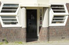 voordeur in Amsterdam School, Amsterdam
