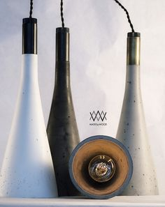 "Lamps shown here in the ""classic"" shape. Stone, Charcoal, and White in color, with varying degrees of blackened bronze ferrule."