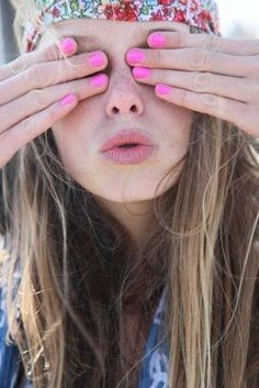 Pink nails to offset a boho outfit.