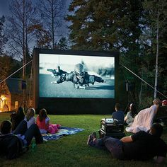 Turn your backyard into an outdoor movie theater Spread blankets on the lawn and invite the family for an outdoor movie night! Backyard theater system has everything you need to watch film stars under the stars. Includes an inflatable screen, audiovisual control and speaker system. All you do is bring the Movie.