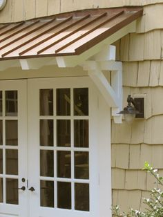Standing seam metal roof with rafters \u0026 brackets for over our bedroom door & roof over front door entrance | Bungalow Restoration: Side door ... Pezcame.Com