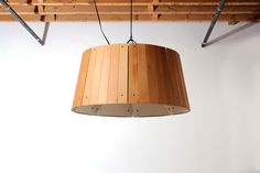 The Refold Lamp by Strand Design, made out of salvaged floor boards. via design*sponge