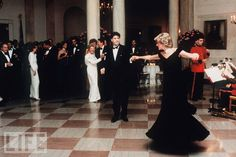 Diana and John Travolta dance at the White House in 1985, as President Ronald Reagan and First Lady Nancy Reagan look on.