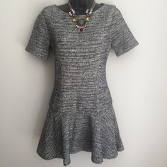 Alice + Olivia Drop Waist Dress NWOT. Paid full retail, but never lost weight to fit into it. Gorgeous high end fabric. Short sleeves, drop flair waist. Textured fabric. Tag says size 6. Fits small/medium. Alice + Olivia Dresses
