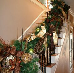 copperandgoldchristmasgarlandonstaircase.jpeg by ChristmasSpecialists, via Flickr