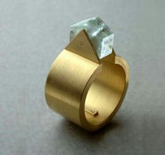 Futuristic ring, gold and aquamarine