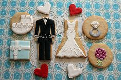 bride and groom cookies with hearts all around!