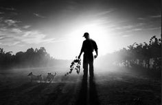 Michael Coyne village life - I love this image because of it's lighting, the way Coyne uses the natural light ti create a dark silhouette out of the farmer makes him seem more iconic and important to the viewer, its his story. Farm Day, William Eggleston, Dramatic Lighting, Dog Silhouette, Documentary Photographers, Visual Effects, South America, Farmer, Documentaries