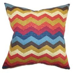 "Cotton pillow with a multicolor chevron motif and feather-down fill.  Made in the USA. Product: PillowConstruction Material: Cotton cover and 95/5 down fillColor: MultiFeatures:  Insert includedHidden zipper closureMade in the USA Dimensions: 18"" x 18""Cleaning and Care: Spot clean"