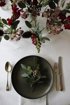Simple, elegant table setting with rich dark hues - lovely for winter!