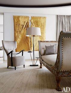 Olga de Amaral created the gilded tapestry in handbag designer Nancy Gonzalez's serene living room.