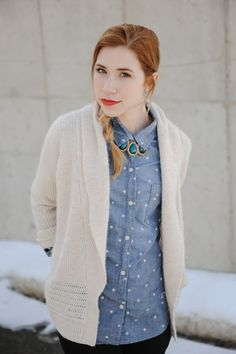 "Fully buttoned up shirt with statement necklace as ""tie"""