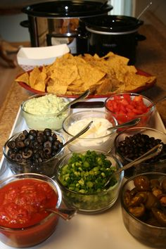 Nacho bar! You could replace the chips with hard and soft shell tacos to make it a Taco Bar..Your great idea for the shower. Now we know how it will look!@Christina Childress Childress Childress Childress Witteried.