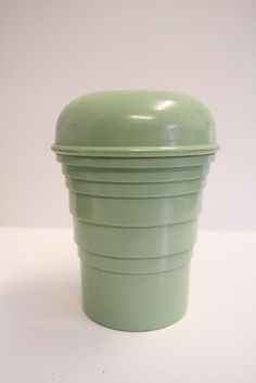 "Bakelite cocktail shaker. ""A quaint mint green Bakelite cocktail shaker, a kitsch addition to your kitchen"" Pinned by www.silver-and-grey.com"