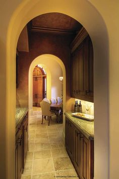 Butler Pantry. Love the arched doorways and crown molding.