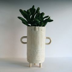 Image of Tall stamped tripod vase with arms //  white
