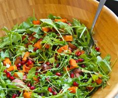 Thanksgiving Salad... 1/2 Pomegranate 1 roasted Butternut Squash 3-6 slices Bacon 1 pkg Arugula Goat Cheese or Other Olive Oil Salt & Pepper Roast butternut squash 400F for 25-30 min until soft. De-seed the pomegranate; Rinse well, and set aside. Cook bacon; Drain on paper towels. The squash and bacon will be warm when added to the salad. Mix everything together in a large bowl with a few glugs of olive oil. Taste for seasoning, S&P to taste.