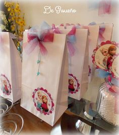 Frozen birthday party favor bags! See more party planning ideas at CatchMyParty.com!
