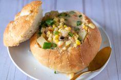 Vegan roasted corn and potato chowder served in a homemade bread bowl. Vegan Baked Potato, Homemade Bread Bowls, Vegan Corn Chowder, Vegan Parmesan Cheese, Vegan Roast, Sliced Turkey, Roasted Corn, Vegan Butter