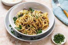 Chopped mushrooms simmer with white wine and parsley to make a quick, easy, memorable sauce for spaghetti.