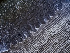One day in a late Autumn I went for a walk to a beach in San Augustin, Maspalomas. Entering it I have noticed the interesting pattern of the beach created by the Atlantic Ocean. The view I have imagined from above was strong enough impulse to go and get my drone for an aerial shot. While flying above I have noticed waves ending on the beach in unusual shapes, reminding of a garland
