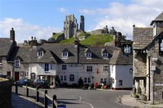 Corfe Castle is a village and civil parish in the English county of Dorset. It is the site of a ruined castle of the same name. England Top, Dorset England, England And Scotland, Walking Holiday, Going On Holiday, Uk Tourist Attractions, Dorset Coast, Corfe Castle, Jurassic Coast