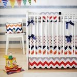 Inspired by the newly popular chevron pattern, our Zig Zag Baby in Rugby Crib Bedding will give your nursery a modern, clean look.  Crisp white & bright boy colors lend a fresh feel to your new baby's room.  Zig Zag Baby in Rugby two piece set includes a crib sheet and skirt. The three piece set includes bumper, sheet and skirt. The bumper is made from White Pique fabric and Nighttime Blue Solid cording with Navy Grosgrain ribbon ties.  Bumper is slip covered for easy cleaning.   Th