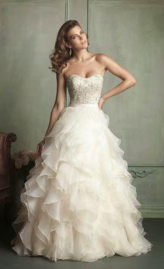 Sleeveless top with flowy full bottom wedding dress