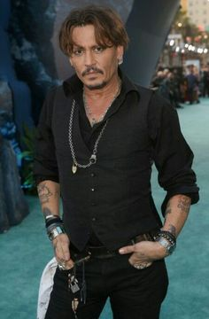 """Johnny Depp Photos Photos - Actor Johnny Depp at the Premiere of Disney's and Jerry Bruckheimer Films' """"Pirates of the Caribbean: Dead Men Tell No Tales,"""" at the Dolby Theatre in Hollywood, CA with Johnny Depp as the one-and-only Captain Jack in a rollick The Hollywood Vampires, Jonny Deep, Here's Johnny, Hot Actors, Pirates Of The Caribbean, Celebs, Celebrities, Beautiful Men, Sexy Men"""